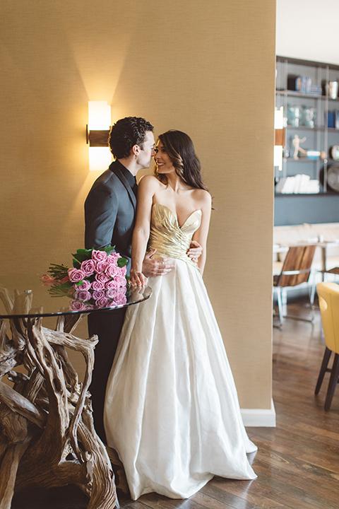 Los-angeles-wedding-shoot-in-santa-monica-bride-and-groom-hugging-far-away