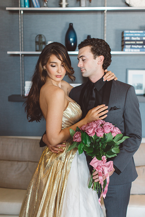 Los-angeles-wedding-shoot-in-santa-monica-bride-and-groom-hugging-holding-bouquet