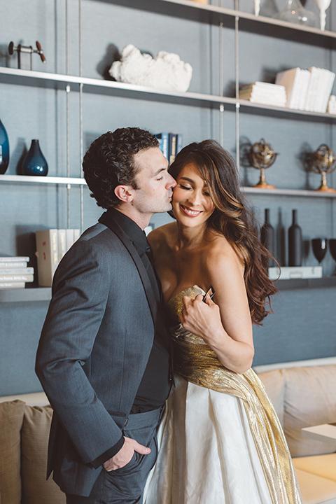 Los-angeles-wedding-shoot-in-santa-monica-bride-and-groom-hugging-with-bouquet