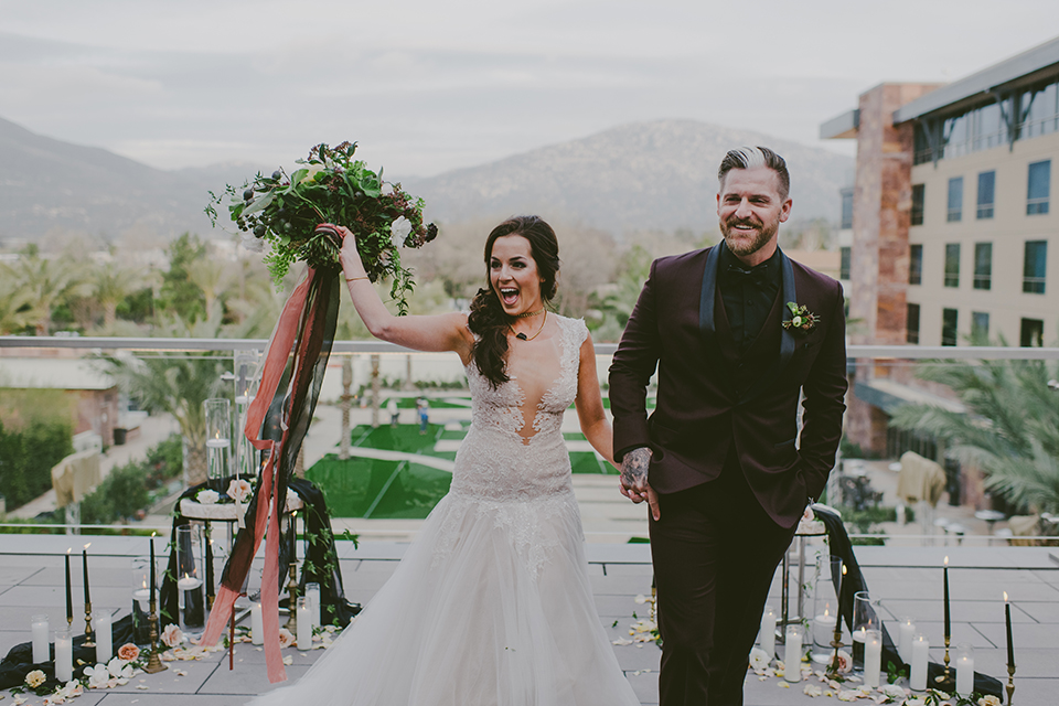 San-diego-outdoor-wedding-shoot-at-viejas-casino-and-resort-ceremony-bride-and-groom-cheering-while-holding-bouquet