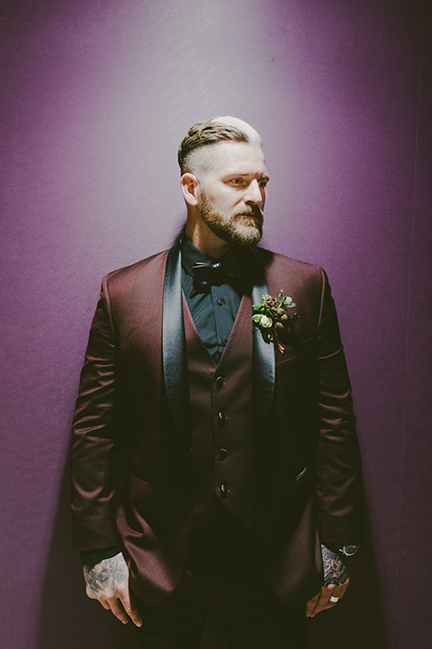 San-diego-outdoor-wedding-shoot-at-viejas-casino-and-resort-groom-burgundy-tuxedo-with-black-bow-tie