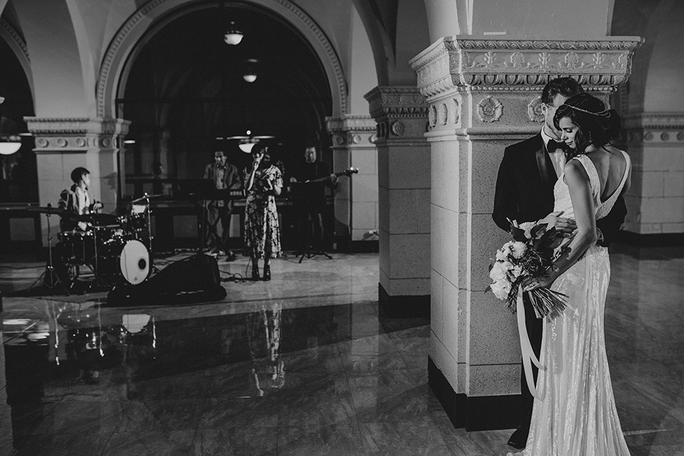 Los-angeles-wedding-at-the-majestic-bride-and-groom-hugging-black-and-white