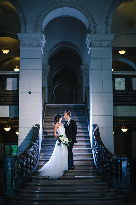 Los-angeles-wedding-at-the-majestic-bride-and-groom-standing-on-stairs-hugging
