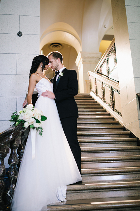 Los-angeles-wedding-at-the-majestic-bride-and-groom-standing-on-stairs-kissing