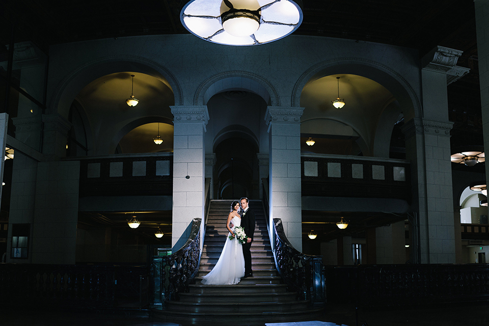 Los-angeles-wedding-at-the-majestic-bride-and-groom-standing-on-stairs-smiling