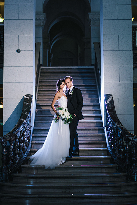 Los-angeles-wedding-at-the-majestic-bride-and-groom-standing-on-stairs