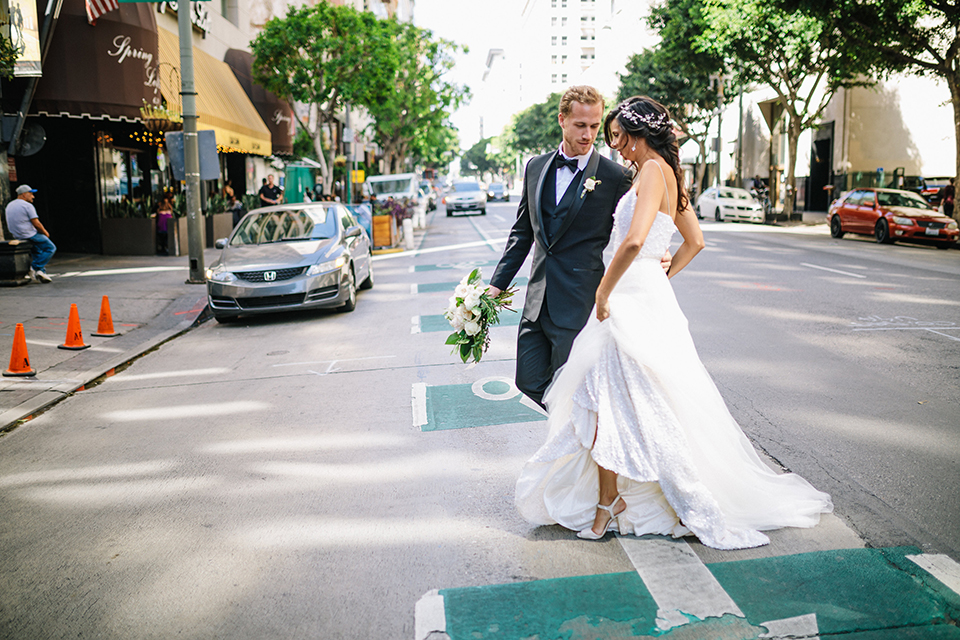 Los-angeles-wedding-at-the-majestic-bride-and-groom-walking-smiling