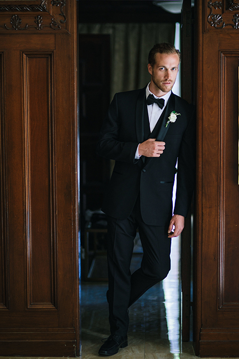 Los-angeles-wedding-at-the-majestic-groom-black-tuxedo-standing