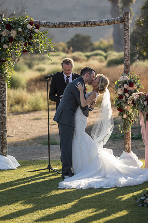 Orange-county-wedding-at-the-hamilton-oaks-winery-ceremony-bride-and-groom-kissing