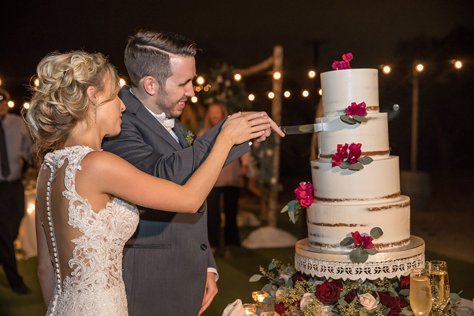 Orange-county-wedding-at-the-hamilton-oaks-winery-reception-bride-and-groom-cutting-cake