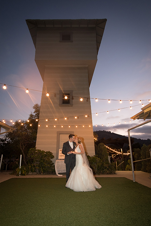 Orange-county-wedding-at-the-hamilton-oaks-winery-reception-bride-and-groom-kissing