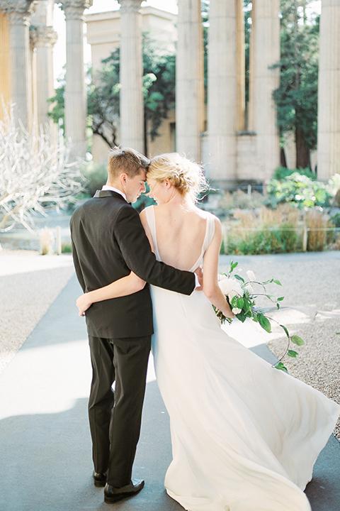 San-francisco-palace-wedding-shoot-bride-and-groom-hugging-back