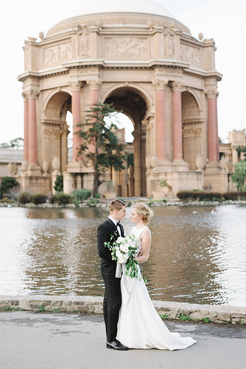 San-francisco-palace-wedding-shoot-bride-and-groom-hugging-far-away