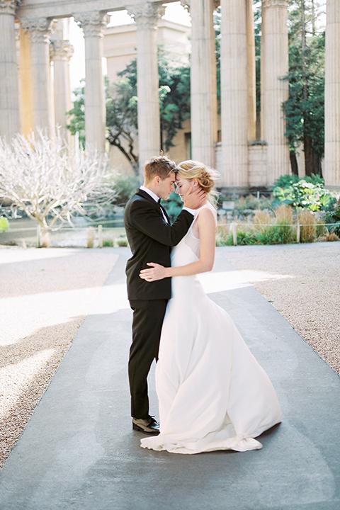 San-francisco-palace-wedding-shoot-bride-and-groom-hugging-smiling