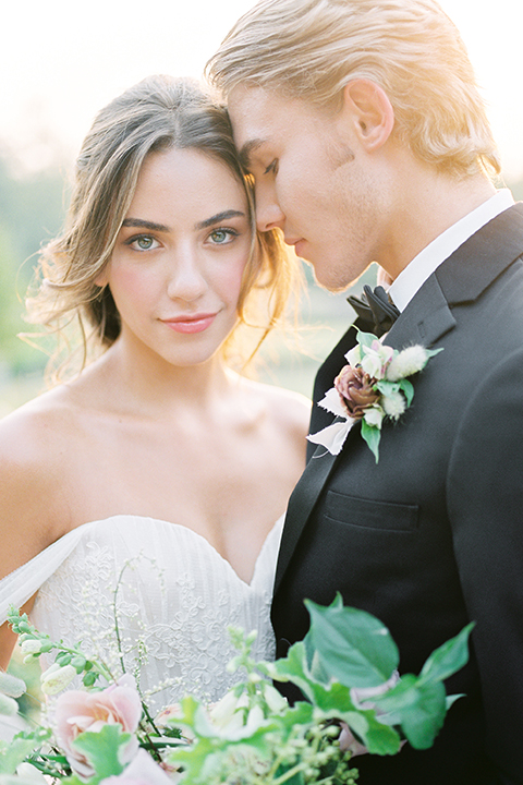 French-inspired-vineyard-wedding-bride-and-groom-hugging-and-smiling-close-up