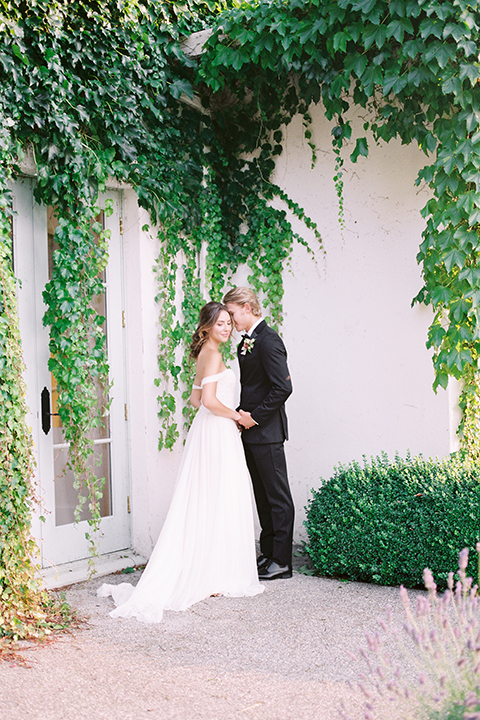 French-inspired-vineyard-wedding-bride-and-groom-hugging-far-away