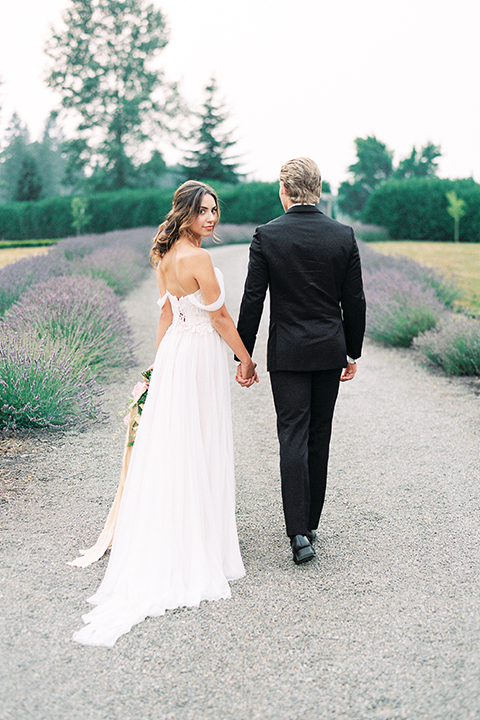 French-inspired-vineyard-wedding-bride-and-groom-standing-holding-hands