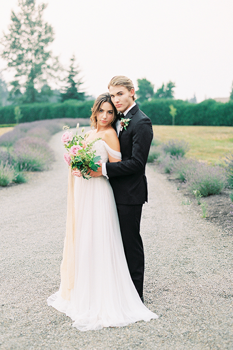 French-inspired-vineyard-wedding-bride-and-groom-standing-hugging
