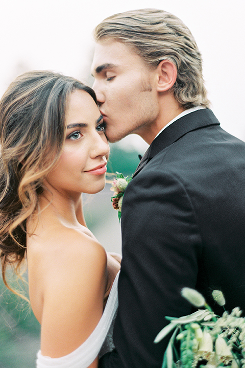 French-inspired-vineyard-wedding-bride-and-groom-standing-kissing