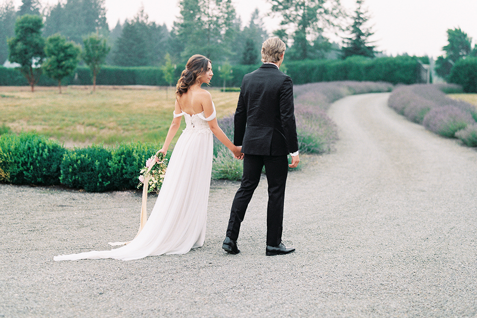 French-inspired-vineyard-wedding-bride-and-groom-standing-walking