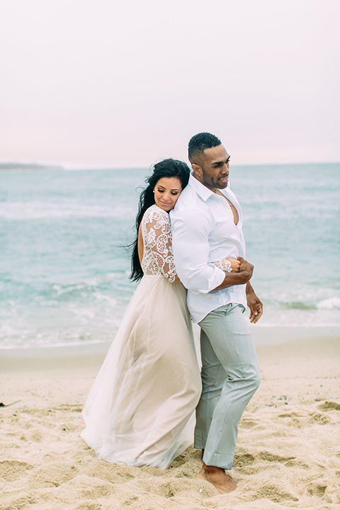 Orange-county-beach-wedding-in-dana-point-bride-and-groom-standing-and-hugging