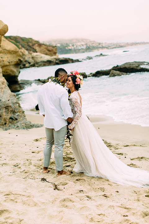 Orange-county-beach-wedding-in-dana-point-bride-and-groom-standing-holding-hands-hugging
