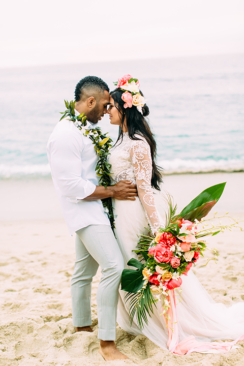 Orange-county-beach-wedding-in-dana-point-bride-and-groom-standing-hugging-close-up