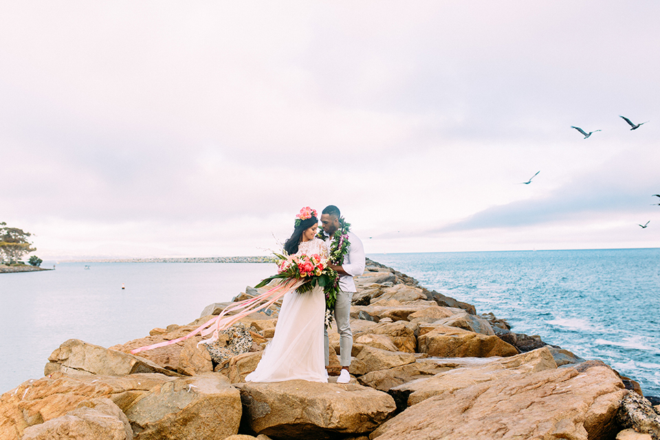 Orange-county-beach-wedding-in-dana-point-bride-and-groom-standing-hugging