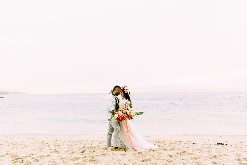 Orange-county-beach-wedding-in-dana-point-bride-and-groom-standing-on-beach-hugging