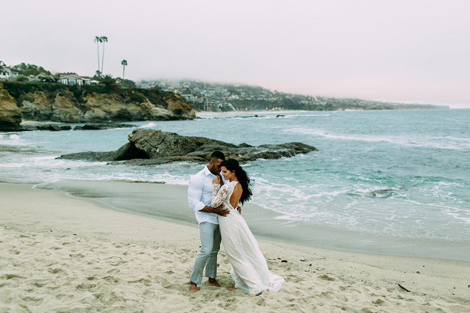 Orange-county-beach-wedding-in-dana-point-bride-and-groom-standing-on-beach