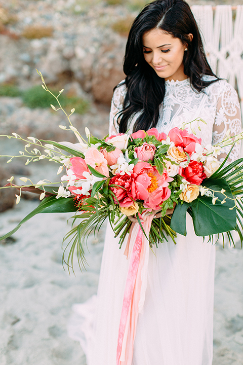 Orange-county-beach-wedding-in-dana-point-bride-holding-bouquet