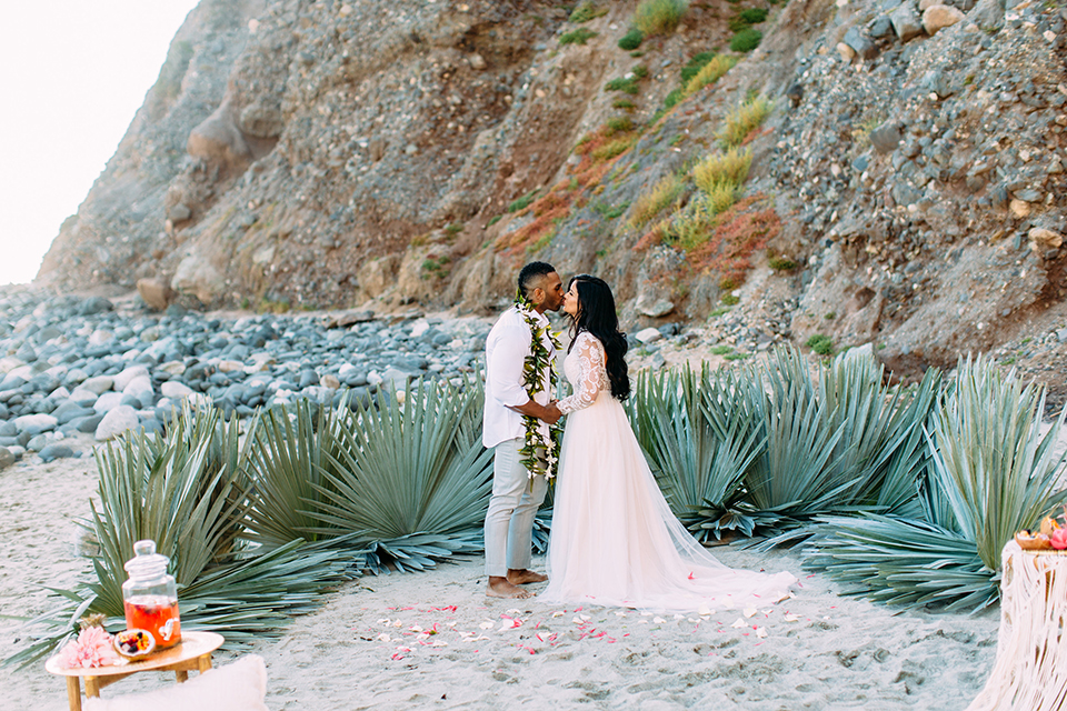 Orange-county-beach-wedding-in-dana-point-ceremony-bride-and-groom-kissing