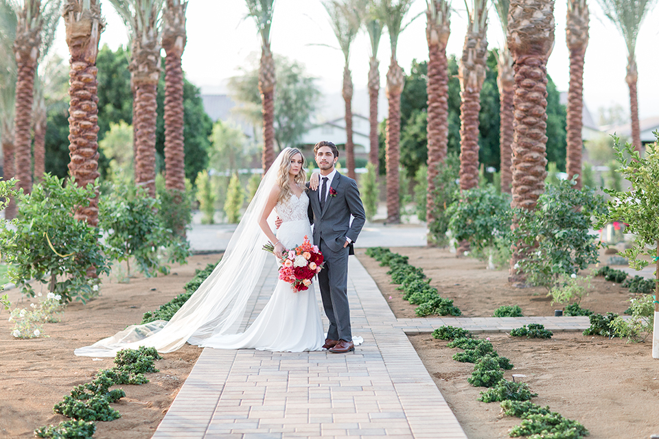 Palm-springs-wedding-shoot-at-old-polo-estate-bride-and-groom-hugging-and-smiling