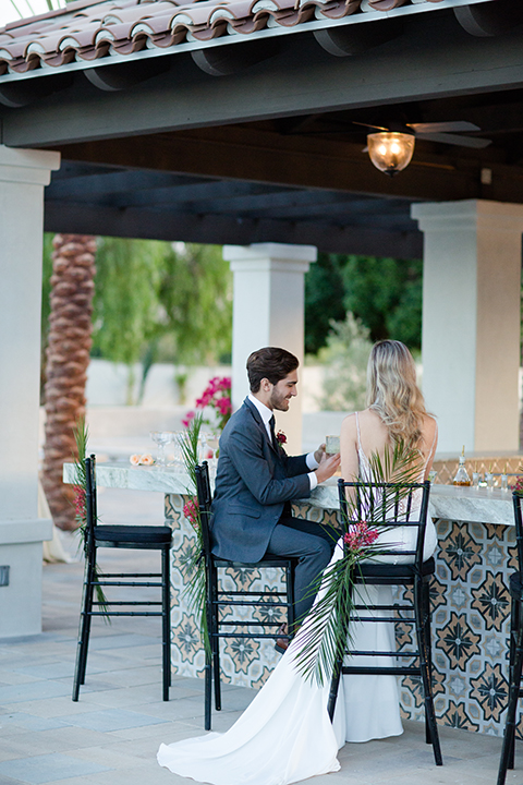 Palm-springs-wedding-shoot-at-old-polo-estate-bride-and-groom-sitting