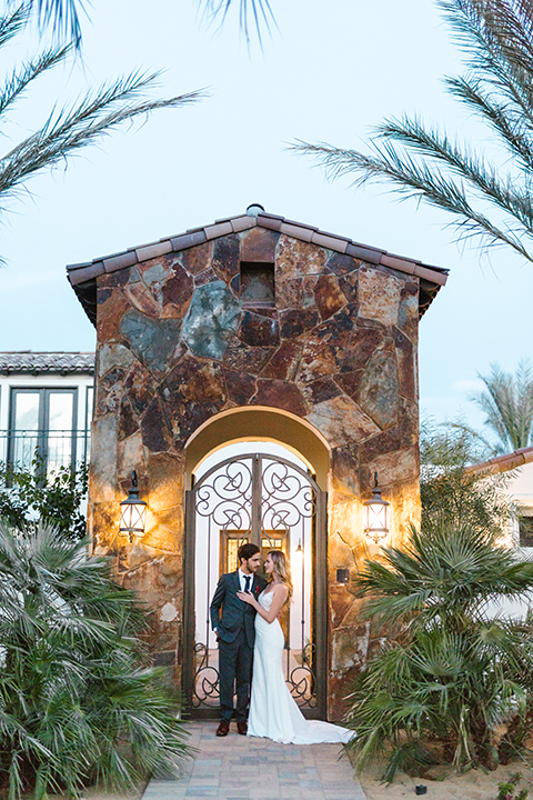 Palm-springs-wedding-shoot-at-old-polo-estate-bride-and-groom-standing-hugging