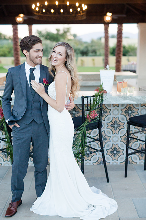 Palm-springs-wedding-shoot-at-old-polo-estate-bride-and-groom-standing-smiling