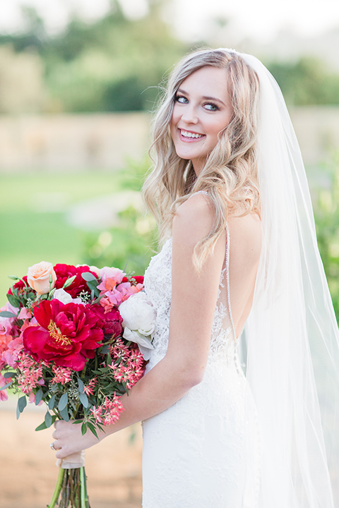 Palm-springs-wedding-shoot-at-old-polo-estate-bride-holding-bouquet
