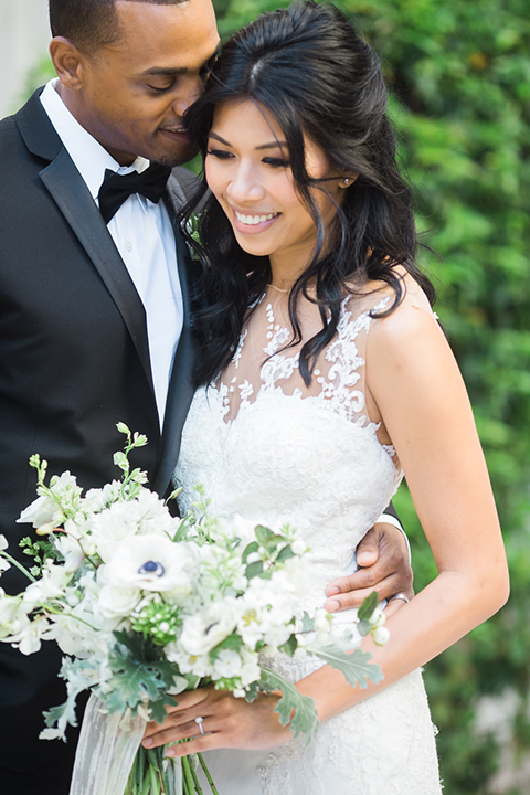 Park-hyatt-aviara-wedding-shoot-bride-and-groom-holding-bouquet-smiling