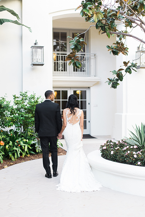 Park-hyatt-aviara-wedding-shoot-bride-and-groom-holding-hands-and-walking-away