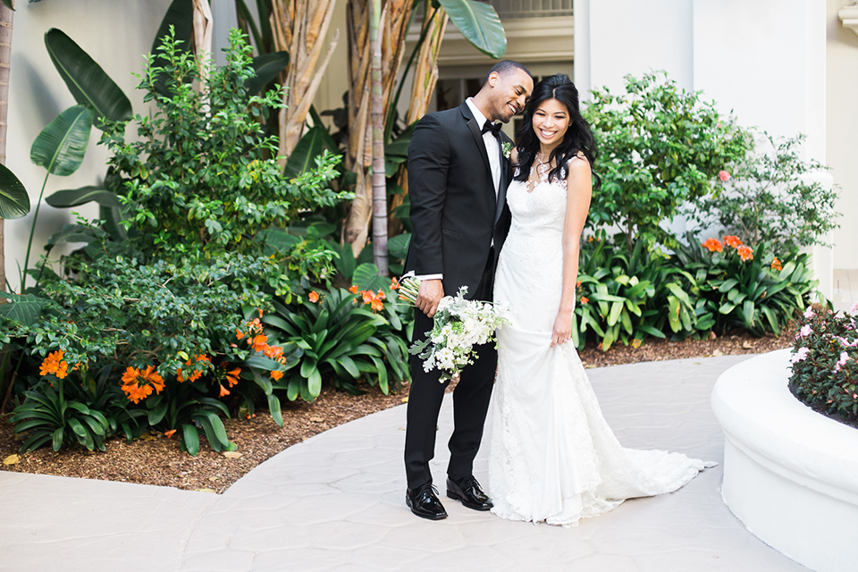 Park-hyatt-aviara-wedding-shoot-bride-and-groom-holding-hands-laughing