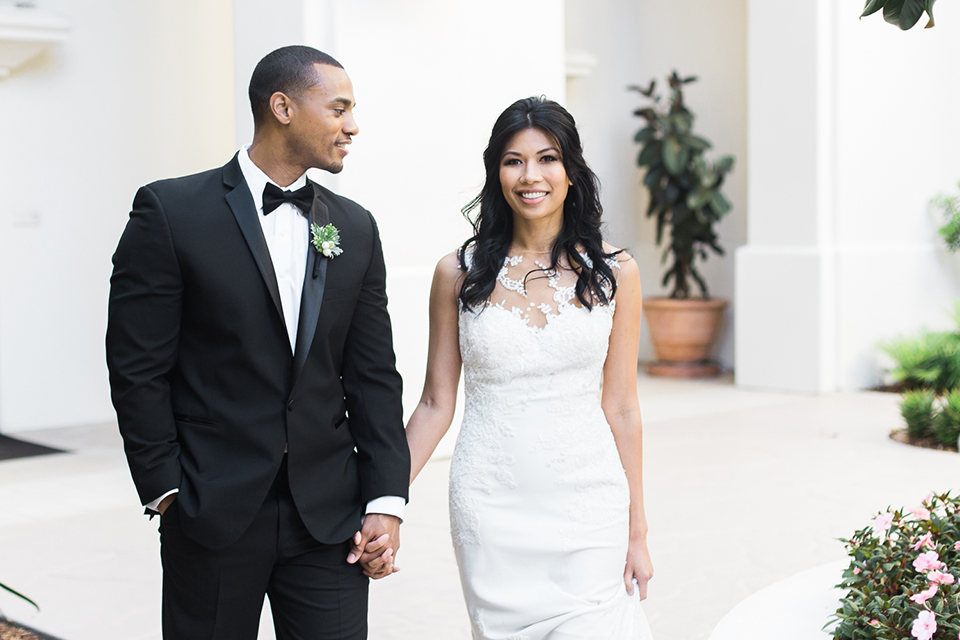 Park-hyatt-aviara-wedding-shoot-bride-and-groom-holding-hands