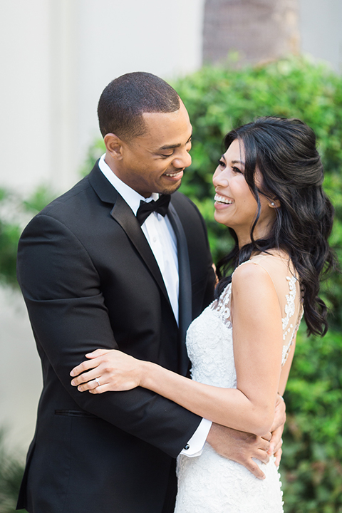 Park-hyatt-aviara-wedding-shoot-bride-and-groom-hugging-laughing