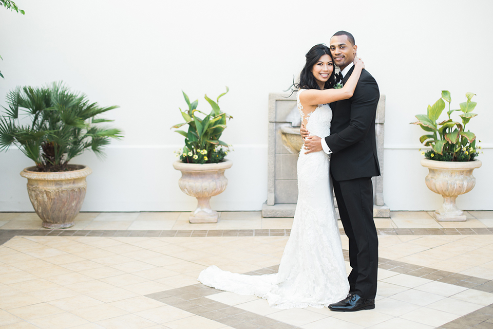 Park-hyatt-aviara-wedding-shoot-bride-and-groom-standing-hugging-close-up