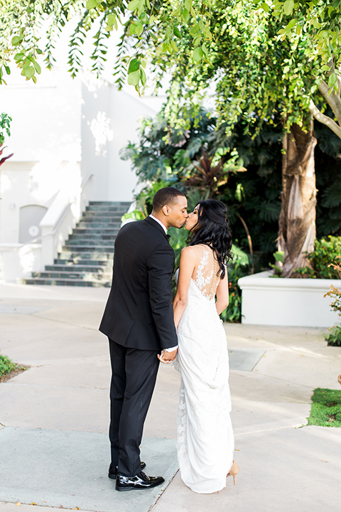 Park-hyatt-aviara-wedding-shoot-bride-and-groom-standing-kissing