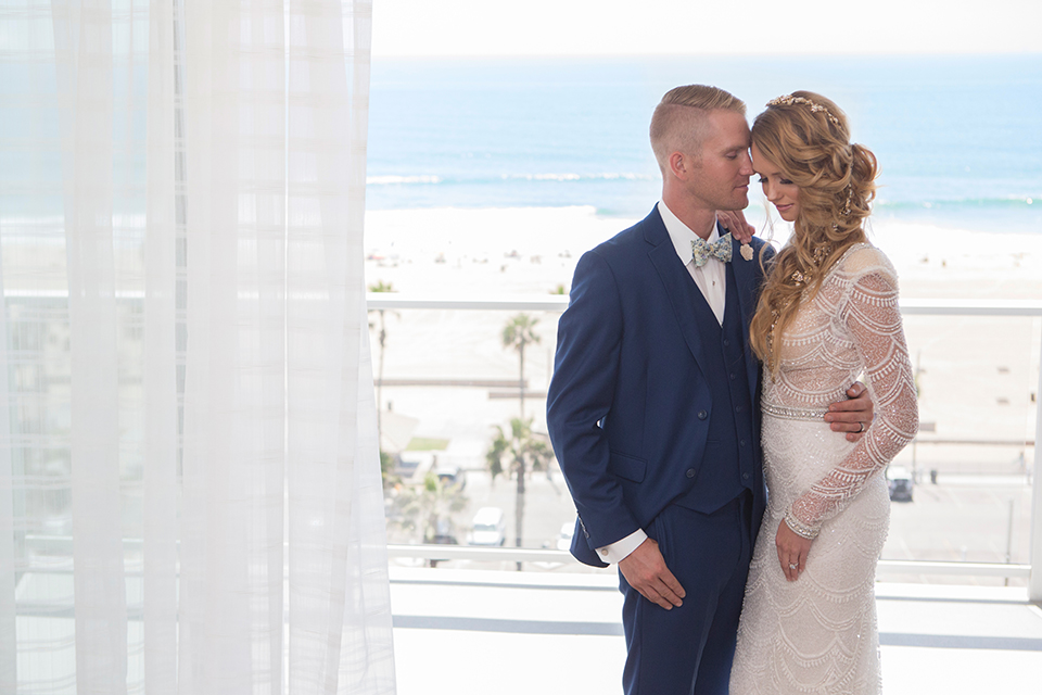 Orange-county-wedding-shoot-at-pasea-hotel-bride-and-groom-blue-suit-hugging