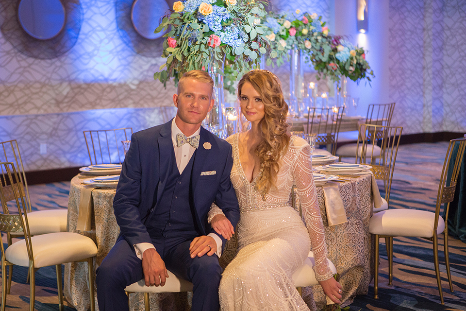 Orange-county-wedding-shoot-at-pasea-hotel-bride-and-groom-blue-suit-sitting-at-table
