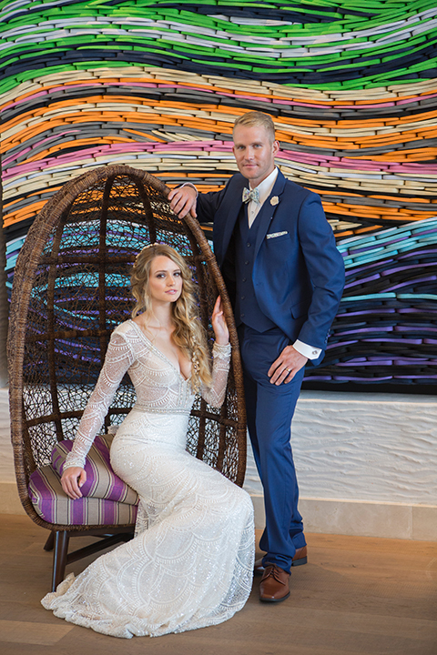 Orange-county-wedding-shoot-at-pasea-hotel-bride-and-groom-blue-suit-sitting-in-chair