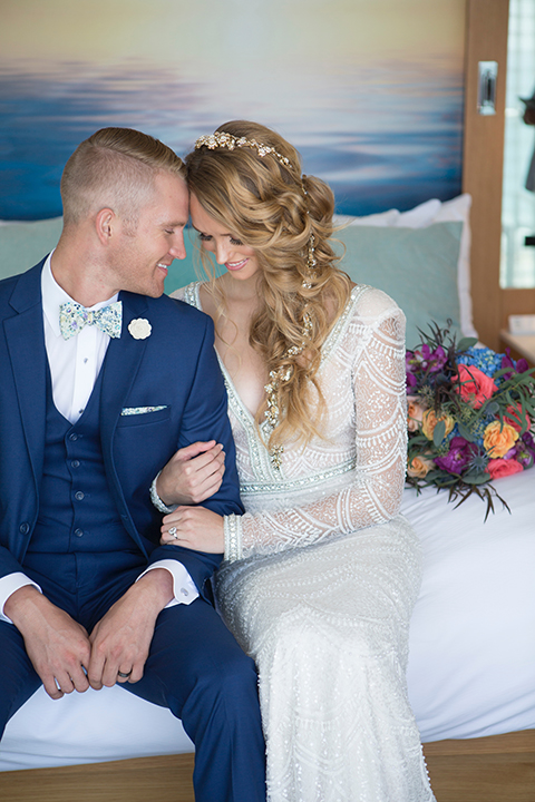 Orange-county-wedding-shoot-at-pasea-hotel-bride-and-groom-blue-suit-sitting