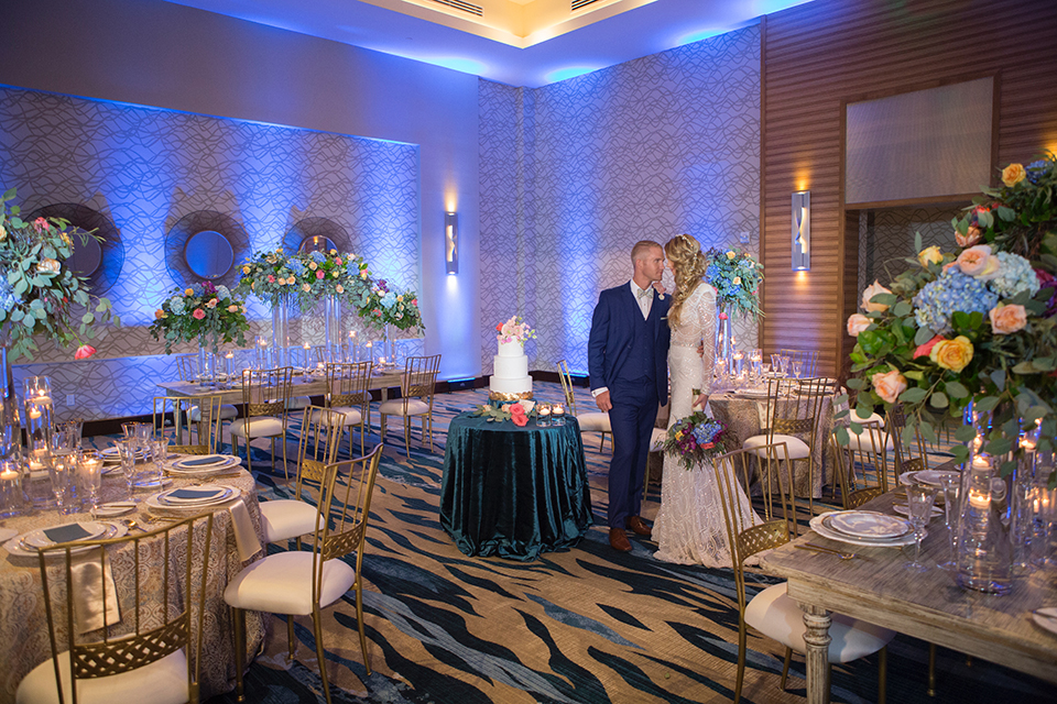 Orange-county-wedding-shoot-at-pasea-hotel-bride-and-groom-blue-suit-standing-by-cake