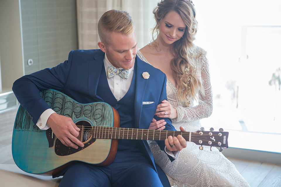 Orange-county-wedding-shoot-at-pasea-hotel-bride-and-groom-playing-guitar